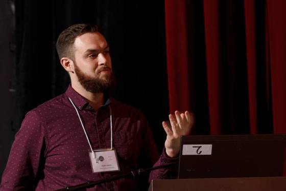 Photo 1 The author's graduate student, Andrew Chaulk, captured in mid-presentation at the ESCJAM 2015 in Montreal. Andrew received an honourable mention for this communication. (photo by Sean McCann)